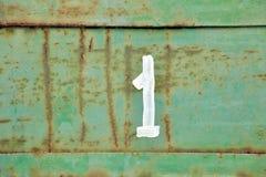 Le schéma un sur le mur Photographie stock