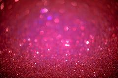 Le scintillement de rouge et de rose soustraient le fond avec du Li defocused de bokeh Photos stock