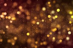 Le scintillement numérique de Noël suscite l'écoulement d'or de bokeh de particules Images libres de droits