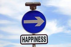 Le signe bleu indique la voie le bonheur Image stock
