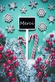 Le signe noir vertical de Noël, lumières, moyens de Merci vous remercient photo stock