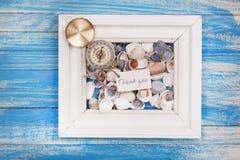 Le signe remercient vous et la boussole dans un cadre blanc - style de vintage images stock