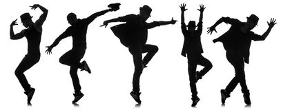 Le siluette dei ballerini nel concetto di dancing Immagini Stock