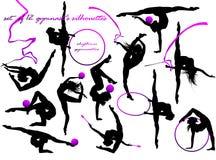 Le siluette della ginnasta Fotografia Stock