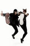 Le siluette di un maschio di due hip-hop e dei ballerini femminili della rottura che ballano sul fondo bianco Fotografie Stock