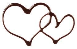Le sirop de chocolat de forme de coeurs Images stock