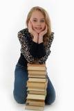 Le skolflickan med böcker Royaltyfria Foton