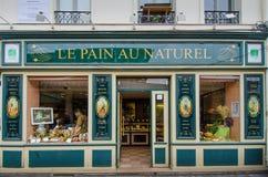 Le Smärta Au Naturel bageri i Paris, Frankrike Arkivfoto