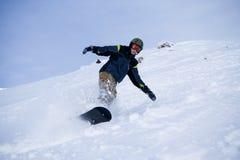 Le snowboarder Photo libre de droits