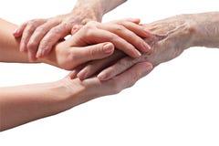 Le soin est à la maison des personnes âgées Photos stock