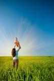 Le soleil de fixation de mère Photographie stock