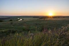 Le soleil de juillet de coucher du soleil Photos libres de droits