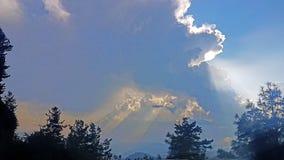 Le soleil de rassemblement de nuages Photos stock