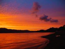 Le soleil de soirée dans le lac Towada Photo stock
