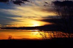 Le soleil se cache Photographie stock libre de droits