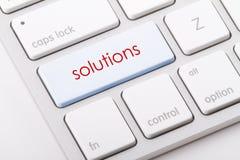 Le soluzioni esprimono sulla tastiera Fotografia Stock Libera da Diritti