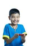 Le sourire asiatique d'enfant reçoivent le cadeau de Noël Photo stock