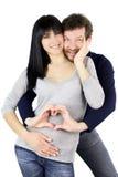 Le sourire européen de couples étreint montrant l'amour se connectent le ventre enceinte Photo stock