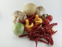 Le spezie e le verdure su fondo bianco Fotografia Stock Libera da Diritti