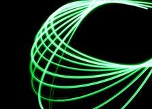Le Spirograph de laser dans le feu vert a augmenté dans une forme de boucle Photo libre de droits