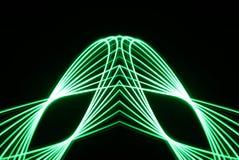 Le Spirograph de laser dans le feu vert a augmenté dans une forme géométrique Photographie stock libre de droits