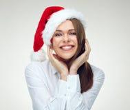 Le ståenden för framsida för santa flickaslut den övre med julhatten Royaltyfri Bild