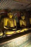 Le statue dorate di Buddha si chiudono su Fotografia Stock Libera da Diritti