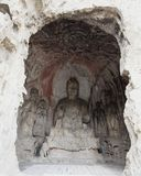 Le statue fini di Buddha delle grotte di longmen sono scolpite sulla scogliera nelle montagne Fotografia Stock Libera da Diritti