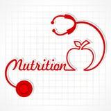 Le stéthoscope font le mot et la pomme de nutrition Photographie stock