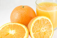 Oranges avec du jus Photo libre de droits