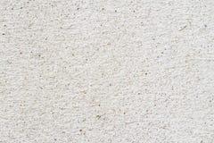 Le style grunge de sable et de pierre de mur en béton donnent au fond une consistance rugueuse Photos libres de droits
