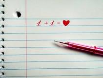 Le stylo et le coeur rouges de gel d'inscription images stock