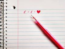 Le stylo et le coeur rouges de gel d'inscription image stock