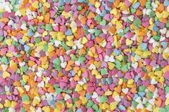 Le sucre arrosent les coeurs de points, la décoration pour le gâteau et la boulangerie Le sucre color? arrose dispers? sur le fon photos libres de droits