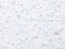 Le sucre blanc de neige pointille le fond Photos libres de droits