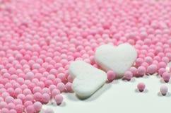 Le sucre coloré de naissance de bébé de fille perle le macro Photographie stock libre de droits