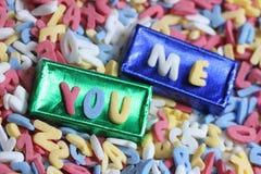 Le sucre marque avec des lettres vous et moi fond Photos stock