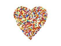 Le sucre perle le coeur coloré Image stock