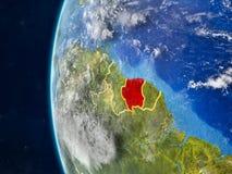 Le Surinam sur le globe de l'espace illustration stock