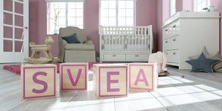 Le svea de nom écrit avec les cubes en bois en jouet chez la pièce du ` s des enfants Photo stock