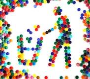 Le symbole réutilisent des capuchons de plastique de couleur Photo libre de droits