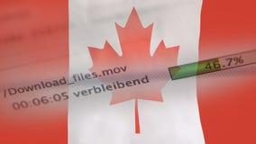 Le téléchargement introduit sur un ordinateur, drapeau de Canada banque de vidéos