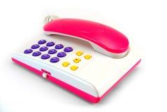 Le téléphone d'une manière fantastique rose Photo stock
