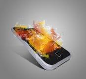 Le téléphone intelligent émet la fumée colorée Photo libre de droits