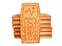 Le téléphone portable de biscuits a isolé Photo stock