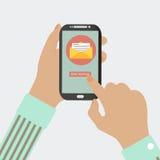 LE TÉLÉPHONE PORTABLE ENVOIENT LE MESSAGE Images stock