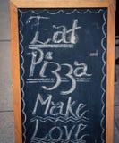 Le tableau mangent de la pizza, font l'amour Images libres de droits