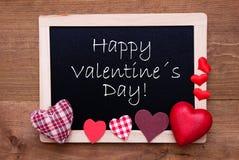 Le tableau noir avec des coeurs de textile, textotent le jour de valentines heureux Photos libres de droits