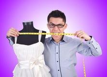 Le tailleur masculin drôle sur le blanc Photo stock