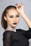 Le talent créatif de fantaisie composent et coiffure sur beau asiatique Photographie stock